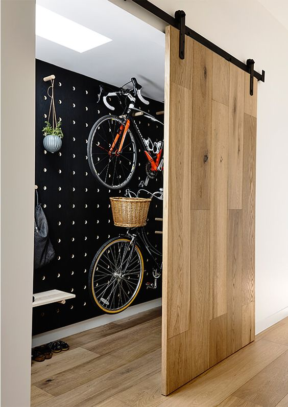 black painted pegboard bike storage