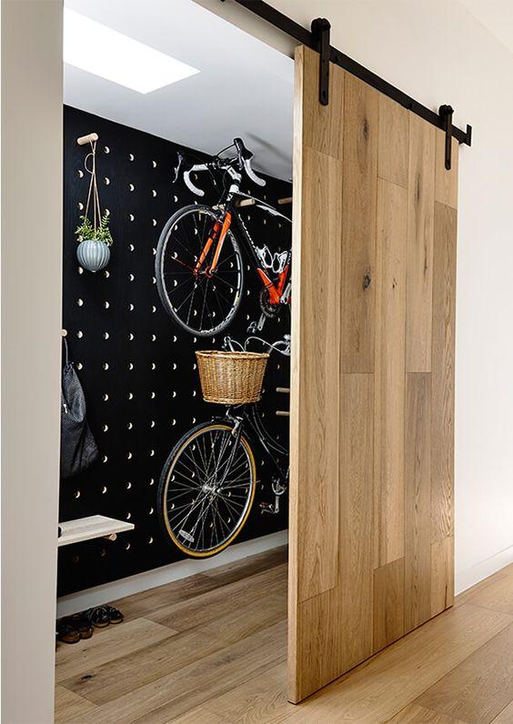 black painted pegboard bike storage